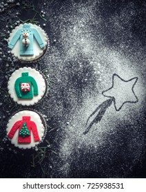 Christmas decorative cupcakes on dark background with blank space