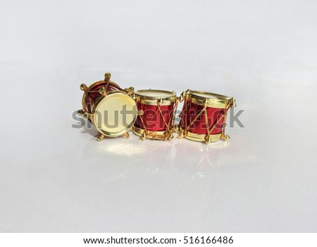 Christmas decorative golden drums.Red gifts reflection
