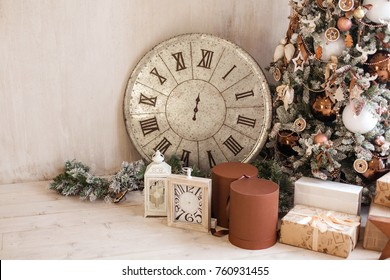 christmas decorative o'clock on 12 hours gifts toys stars garland and fire in background bokeh lights holiday concept