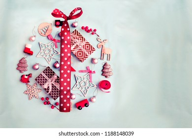 Christmas decorative ornaments and gifts on pastel background in vintage color