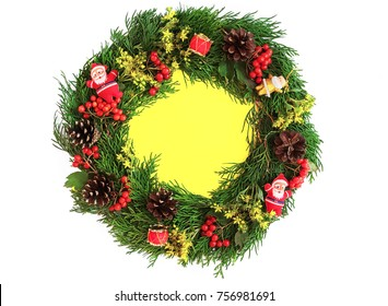 Christmas decorative wreath  with ornament isolated on white background. Made from thuja, flower, pine cones Floral design. Festive mod