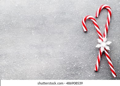Christmas decors with gray background. Candy cane.