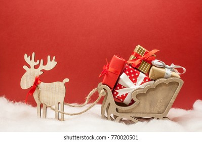 christmas deer with sledges and presents