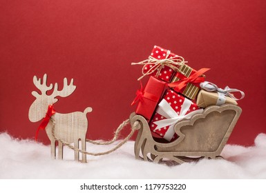 christmas deer with sledges and presents festive mood