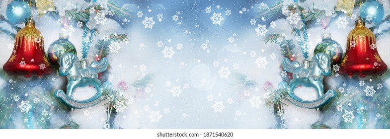 Christmas defocused widescreen background with decorated fir branches, bokeh and snowflakes New year winter art design, banner