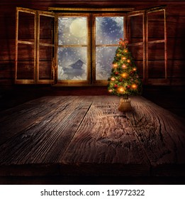 Christmas design - Christmas tree. Xmas winter background in wooden cabin with Christmas tree and window with winter night in the background.