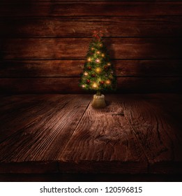 Christmas design - Christmas tree. Xmas winter background in wooden cabin with Christmas tree and wall in the background.