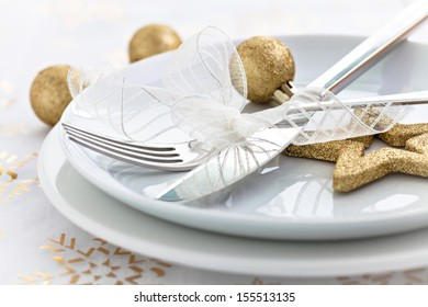 christmas dinner with golden decoration