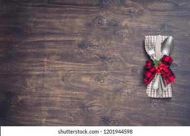 Christmas dinner table setting decoration on wooden background, toned
