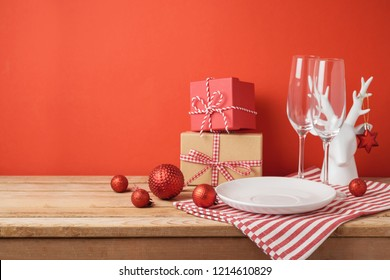 Christmas dinner table setting with empty plate and decorations. Christmas and New Year background