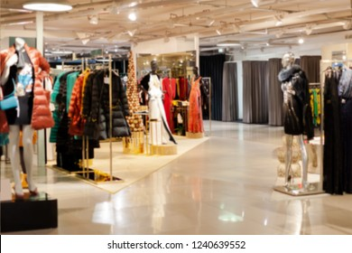 Christmas discounts. Blurred showcases fashion boutique fashionable clothes. Blurred bokeh basic background for design. interior shop boutique background. Big sales. - Image