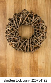 Christmas door wreath brown twigs on sapele wood background, copy space