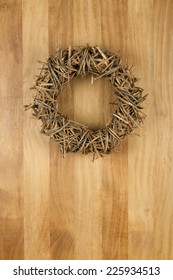 Christmas door wreath light brown twigs on sapele wood background, copy space