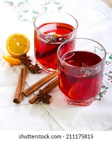 Christmas drink with lemon, star anise and cinnamon sticks in glasses