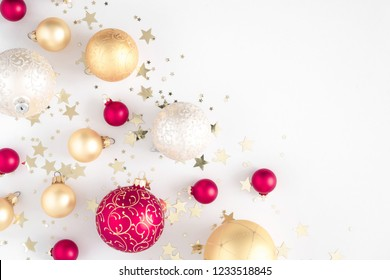 Christmas elegant composition. Christmas red and gold decorations on white background. Christmas, New Year, winter concept. Flat lay, top view, copy space