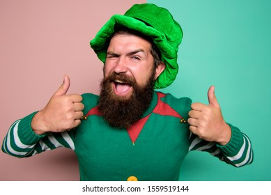 Christmas elf. Elf concept. Happy celebration. Bearded elf. Winter carnival. Best day ever. St Patricks day. Hipster with beard wearing green party costume thumbs up. Cheerful man celebrate holiday.