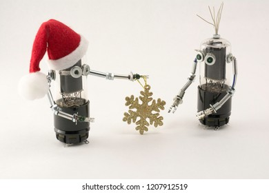 Christmas elf handing snowflake to robot