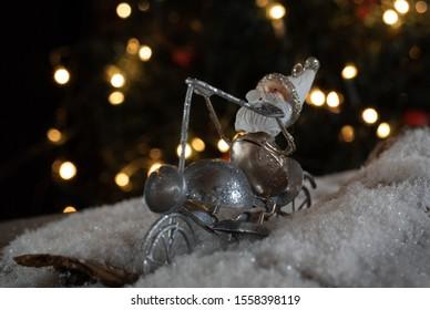 Christmas elf riding a silver motorcycle