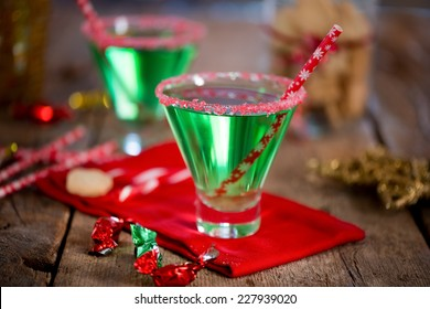 Christmas emerald green cocktail, glass rimmed with crushed candy cane. Great drink for entertaining.