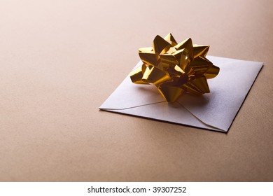 christmas envelope with decorative ribbon on gold background