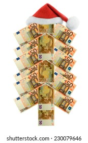 Christmas european banknote fir tree and claus hat isolated over white
