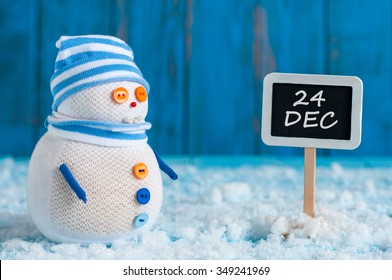 Christmas Eve Date On sign. December 24. Snowman near direction Sign. Xmas Decorations