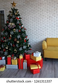 Christmas eve and holiday photo. A big Christmas tree and set of colorful box gifts , decoration toy lying on modern wooden floor background.