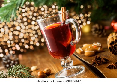 Christmas Eve mulled wine in glass with citrus fruits and spices. Tasty traditional hot drink.