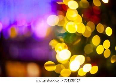Christmas Eve, New Year decoration lights bokeh blurred background.
