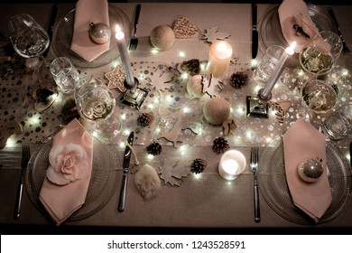 christmas eve party table with wine glass and glitter season's greeting decoration