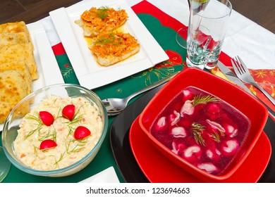 Christmas eve table with glass of wine and traditional polish food