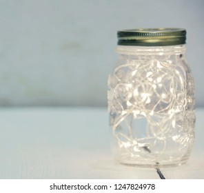 Christmas fairy lights in a mason jar