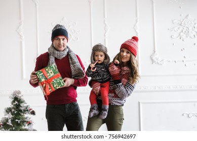 Christmas family celebrates holiday with gifts
