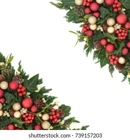 Christmas festive background border with red and gold bauble decorations, holly, ivy, mistletoe, fir and pine cones on white.