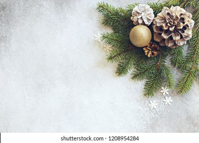 Christmas festive background with fir brunch and cones. Overhead view, copy space