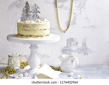 Christmas festive carrot cake with mascarpone filling on a light slate,stone or concrete backdrop.
