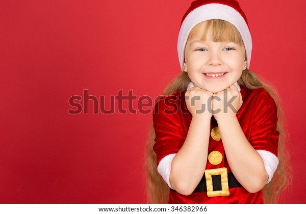 b9be057073910 Christmas fever. Horizontal portrait of a little adorable girl in Christmas  outfit posing in studio