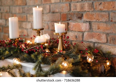 Christmas fir with candles and berries