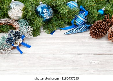 Christmas fir tree balls blue decoration on a white wooden board. Empty space for design. Holiday ideas, natural light