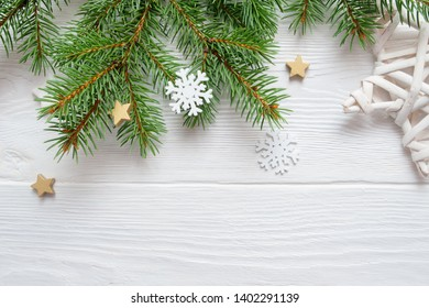 Christmas fir tree branch on white wooden background. Pine branch. Place for text. Elements for decoration of x-mas decor branch of green spruce