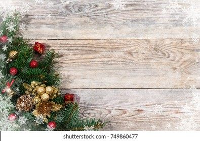 Christmas fir tree branches with toys on old wooden table