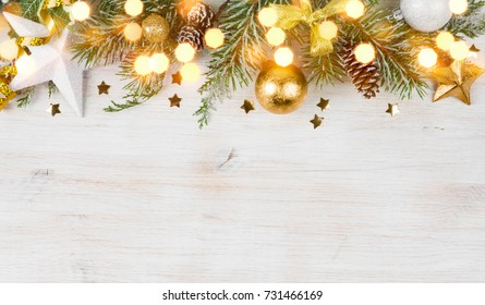Christmas fir tree with decoration and glitters on wooden background