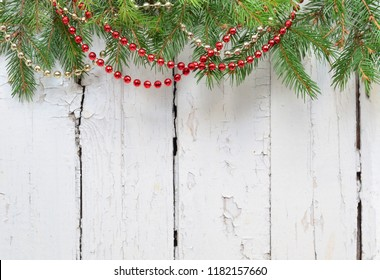 Christmas fir tree with decoration on a wooden board.