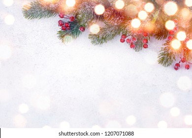 Christmas fir tree with decoration on white snowy background