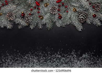 Christmas fir tree with decoration on dark background