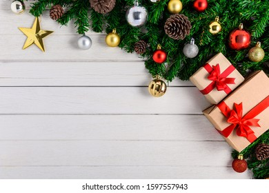 Christmas fir tree with decoration on white wooden board. Top view with copy space