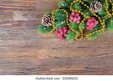 Christmas fir tree with decoration on brown wooden background. Top view