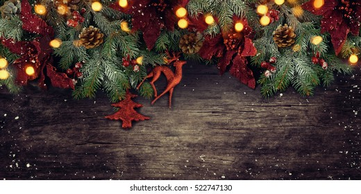 Christmas fir tree with decoration on wooden board.