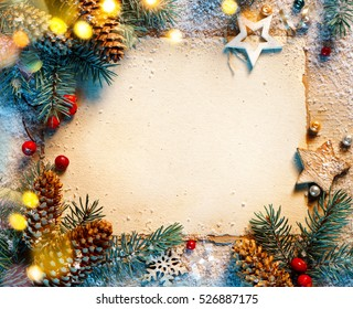 Christmas fir tree with greeting card on wooden background. Merry Christmas and Happy New Year!! Top view.