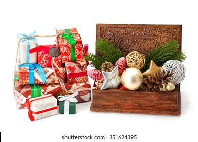 Christmas fir twigs, toys and gifts isolated on white background